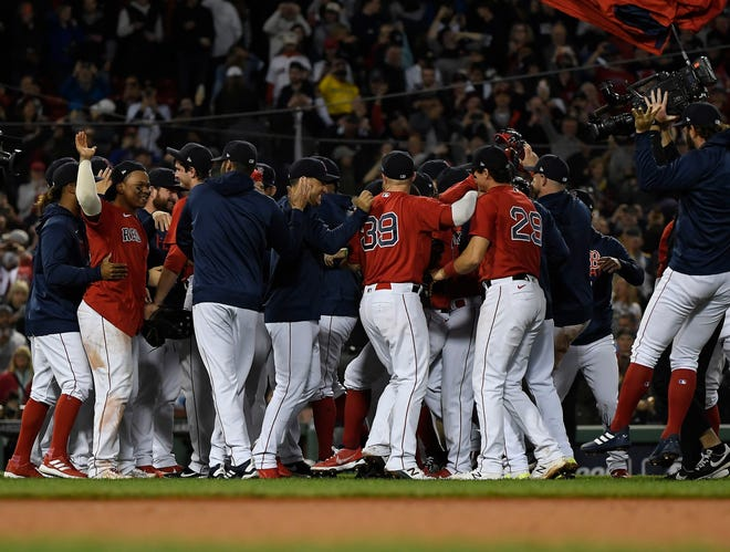 Oct 5, 2021; Boston, Massachusetts, USA; Boston Red Sox celebrate the 6-2 victory against the New York Yankees in the American League Wildcard game at Fenway Park. Mandatory Credit: Bob DeChiara-USA TODAY Sports