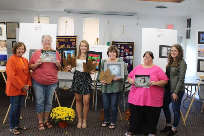 The winners of the Morgan County Fall Foliage Festival Photography Contest were announced Tuesday afternoon. The contest was sponsored by the Martinsville Arts Council. Judy Byers, left, FFF board member; Nancy Rickelman, second place color; Katherine Jackson, Best of Show and first place color; Dawn Throckmorton, first place black and white; Laura Cook, third place black and white; Anne Gee, Martinsville Arts Council pose for a photo Tuesday evening. Not pictured is Carole Graphman, second place black and white and third place color.