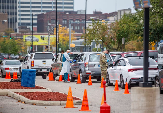 Indiana Department of Health operates a drive-thru COVID-19 vaccine and testing site in a parking lot outside Four Winds Field on Wednesday, Oct. 6, 2021, in South Bend.