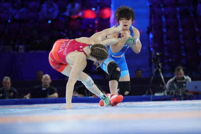 USA's Sarah Hildebrandt, Granger native, tries to escape Japan's Remina Yoshimoto during Wednesday's 50 kg gold medal match of the United World Wrestling Championships in Oslo, Norway.