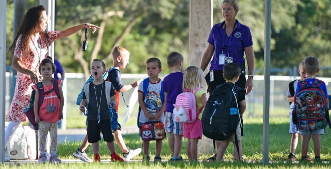 Students returned to school Tuesday (August 10, 2021) morning in Manatee and Sarasota counties, and for many it was the first time attending school without a mask on in more than a year. THOMAS BENDER/ SARASOTA HERALD-TRIBUNE