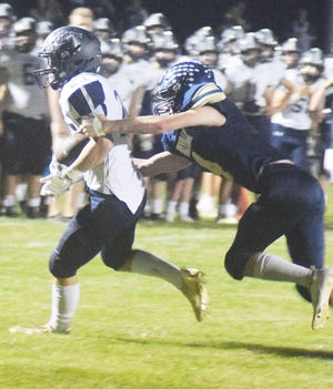 Annawan-Wethersfield's Cole Troxell runs breaks a tackle for a long gain against Knoxville last Friday.