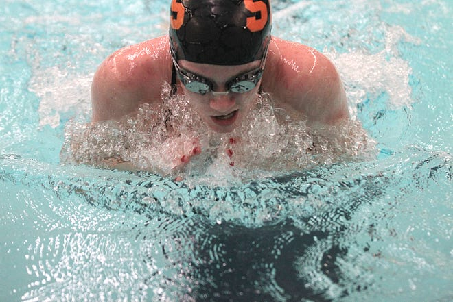 Senior Katie Strawser swims the breaststroke portion of the 200 medley relay on Tuesday.