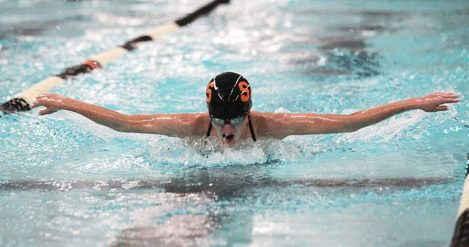 Sturgis' Kenzy Triezenberg swims in the 200 individual medley on Tuesday.
