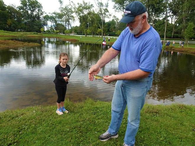 Mike Scheetz and his niece, Piper, caught a small blue gill at the Stark Parks Ranger for a Day event when they joined in on the fishing at Tam O'Shanter park on Sept. 25