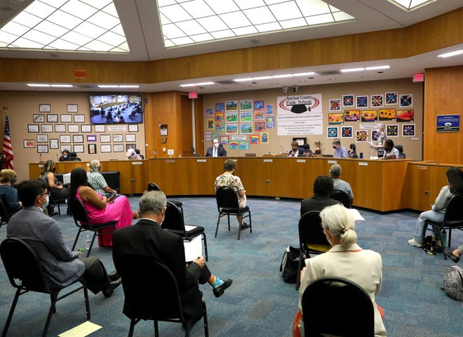 The Alachua County Public School Board from left to right, Mildred Russell, Robert P. Hyatt, chair Leanetta McNealy, Gunnar F. Paulson and Tina Certain, meet at the school board meeting room in Gainesville on Oct. 5.