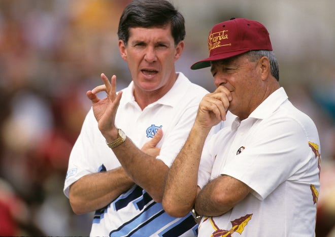 North Carolina coach Mack Brown, left, talks with Florida State coach Bobby Bowden on the field at Doak Campbell Stadium in Tallahassee, Fla., in this photo from October 1992.