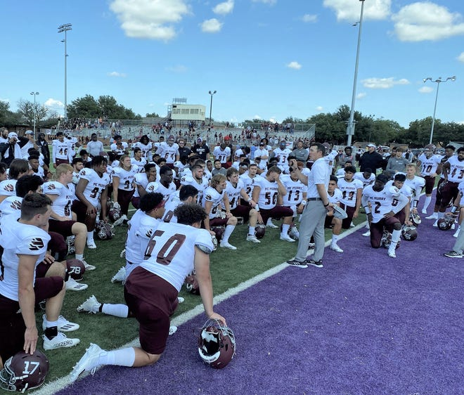 McMurry War Hawks coach Jordan Neal encourages his players after a close 24-21 loss to Hardin-Simmons on Saturday at Shelton Stadium. McMurry led until early in the second half. Oct 2 2021