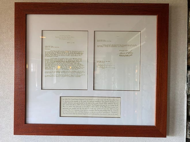 """The framed agreement between the U.S. Supreme Court and the Omni Grove Park Inn remains on display at the hotel in North Asheville. Dating to 1956, It includes a brief explanation, which concludes by noting the inn """"remains happily bound to welcome the Court should there ever be need."""""""