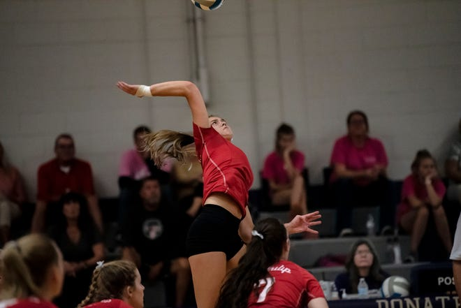 St. Philip senior Brooke Dzwik (9) spikes the ball on Tuesday, Oct. 5, 2021 at Athens High School.