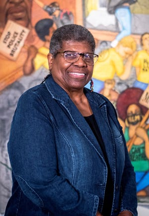 Carolyn L. Mazloomi is named a 2021 Enquirer Woman of the Year. She works to empower people of color to tell their stories through organizations like the Women of Color Quilters Network and strives to educate the public about the Black experience through her art.