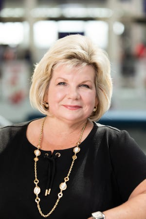 Candace McGraw is recognized as a 2021 Enquirer Woman of the Year. She has been the CEO of Cincinnati/Northern Kentucky International Airport since 2011.