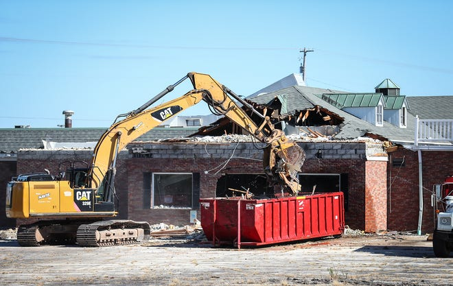 A hydraulic excavator operator begins demolition Wednesday of the former Schreiner's Restaurant at the intersection of Johnson Street and Pioneer Road in Fond du Lac. The spot will be occupied by a Kwik Trip.