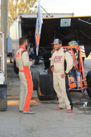 Brotherly love as DJ Foos, left, chats with Matt Foos before rain canceled racing at Fremont Speedway. DJ Foos is 410 champ and Matt Foos is champ in the 305s at Fremont.