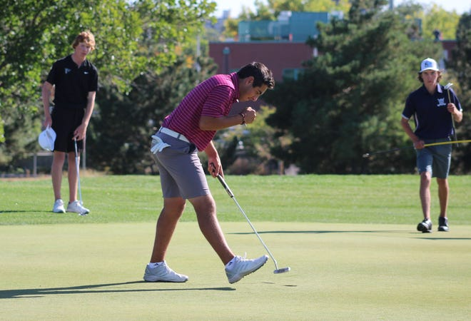 Windsor High School golfer Brentyn Paiz pumps his fist after making a key putt while shooting a 3-under-par 67 in the final round Tuesday, Oct. 5, 2021, to win Colorado's Class 4A state championship at City Park Golf Course in Denver.