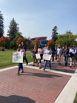About 120 students at the University of Montana Law School in Missoula held a demonstration Tuesday calling for the resignation of the school's leadership over claims that the dean and associate dean discouraged reporting sexual assaults.