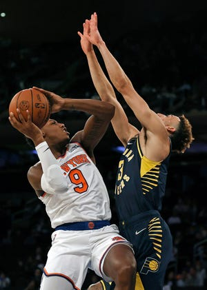 New York Knicks guard RJ Barrett (9) drives to the basket against Indiana Pacers guard Chris Duarte (3) during the second half of a preseason NBA basketball game Tuesday, Oct. 5, 2021, in New York. The Knicks won 125-104. (AP Photo/Adam Hunger)