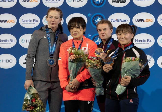 (L-R) Second placed USA's Sarah Ann Hildebrandt, first placed Japan's Remina Yoshimoto, third placed Russia's Nadezhda Sokolova and third placed Mongolia's Otgonjargal Dolgorjav pose on the podium after winning the women's 50 kg category of the 2021 Wrestling World Championships in Oslo, Norway, on October 6, 2021.