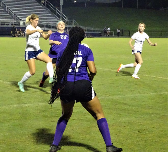 Lancaster's Kara Weaver (3) fights for the ball against a Pickerington Central defender while teammate Marisa Heil looks on during Tuesday's Ohio Capital Conference-Buckeye Division match. The Lady Gales pulled out a 1-0 victory.