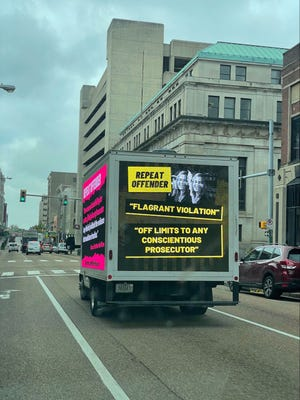 A mobile billboard attacks Shelby County District Attorney General Amy Weirich's prosecutorial record Wednesday, Oct. 6, outside 201 Poplar.