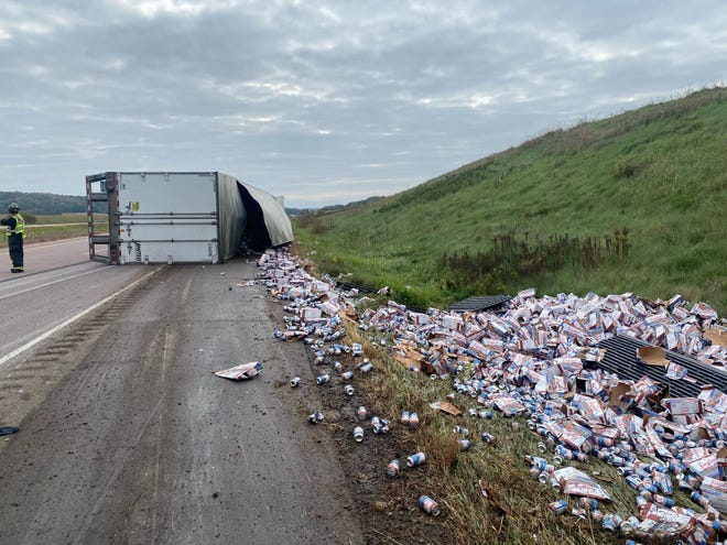 A semi rollover on Interstate 94 resulted in Leinenkugel's beer being spilled on the side of the road.