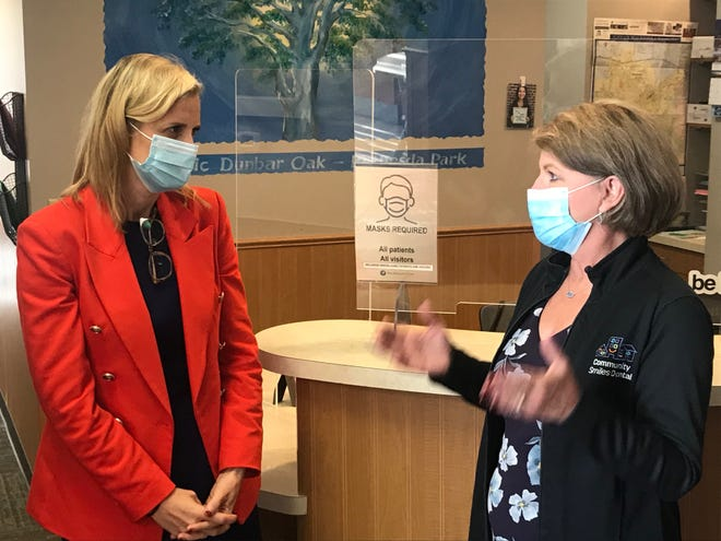 Democratic U.S. Senate candidate Sarah Godlewski, left, listens to Renee Ramirez, chief executive officer of Community Smiles Dental, during a tour of the group's facility in Waukesha Oct. 6, 2021.