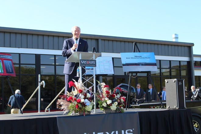 Arkansas Gov. Asa Hutchinson speaks Monday morning at a news conference announcing that Flippin's Vexus Boats would expand its production facilities and add 50 full-time jobs.