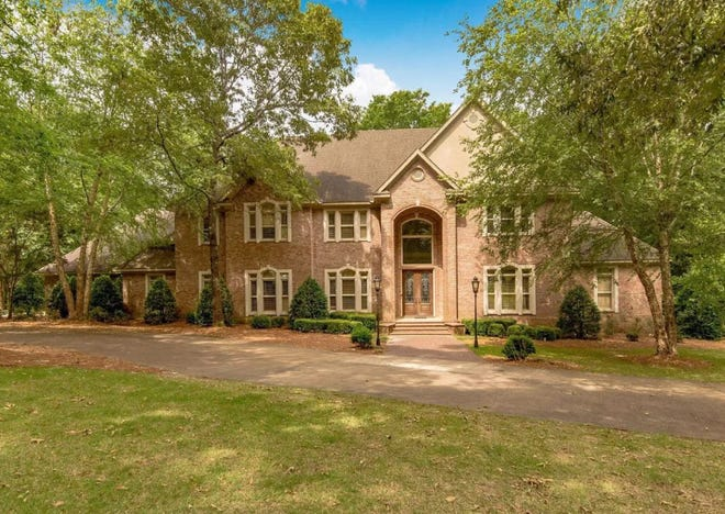 A majestic estate home at 503 Fiveash Oaks in Prattville stands two stories on a five-acre lot flush with towering trees and beautiful landscaping. The property is on the market for $784,900. Inside are six bedrooms along with three full bathrooms and three half-baths.