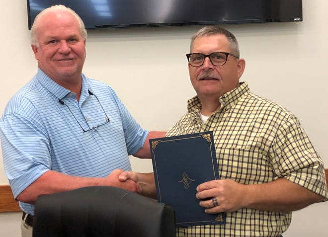 Dickson Mayor Don Weiss, left, presents a proclamation to Jon 'Bird' Armstrong, right, in recognition of his 12 years of service on the Dickson City Council.