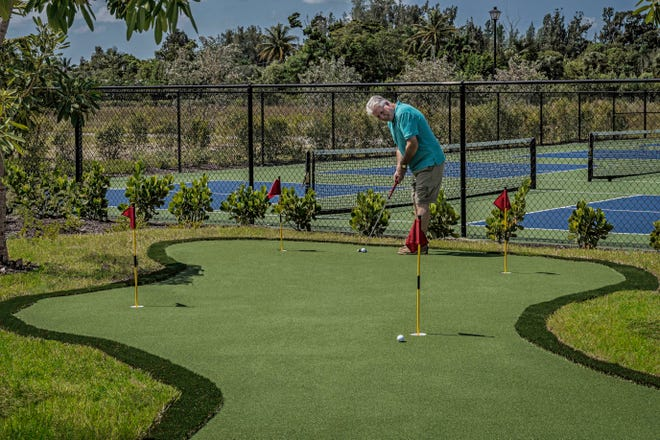 A new putting green is included in the comprehensive amenity package at Antilles.