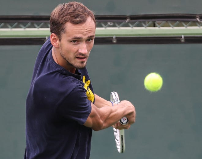 Daniil Medvedev eyes a return during practice at the BNP Paribas Open in Indian Wells, October 6, 2021.