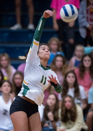Amiah Butler (11) plays the ball during the Catholic vs Gulf Breeze volleyball match at Gulf Breeze High School on Tuesday, Oct. 5, 2021.