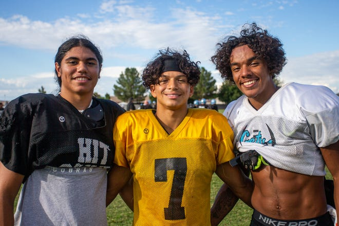 Cactus High School Football Wide Reciever Joseph Lagafuaina (left), Quarterback Will Galvan (center), and Wide Reciever Chris Thomas (right) at Football Practice in Glendale, AZ at the Cactus High School Practice Fields on October 5, 2021