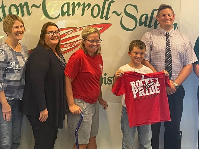 Braxtyn Hansen, 9, was recognized by the Benton-Carroll-Salem Local School Board for his fundraising efforts to help his former second-grade teacher, Kathy Spangler, who is battling cancer.