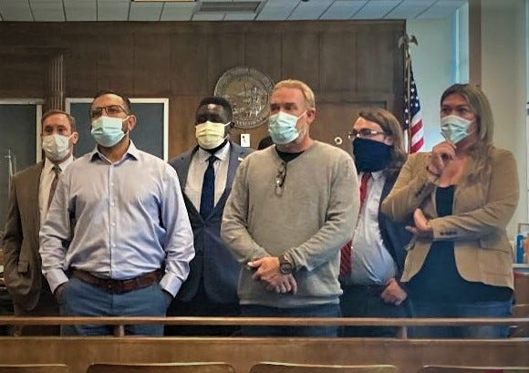 Carlos Zapata, second from left in light blue shirt, one of the leaders of the movement to recall three Shasta County supervsors, was found not guilty of battery Wednesday in Shasta County Superior Court. However, Zapata was found guilty of disturbing the peace.