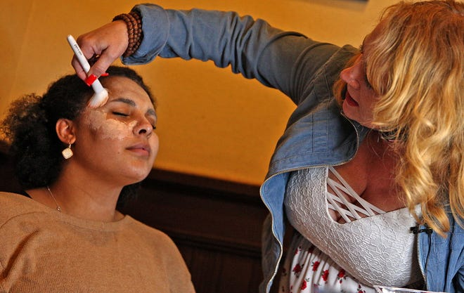 Robin Pullman, right, applies makeup to Mackailyn Johnson, left, at a haunted house training session at the Railway Museum of San Angelo on Tuesday, Oct. 5, 2021.