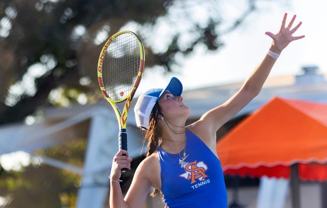 San Angelo Central's Olivia Henderson hits a serve during a match against Abilene High at the Tut Bartzen Tennis Complex on Tuesday, Oct. 5, 2021.