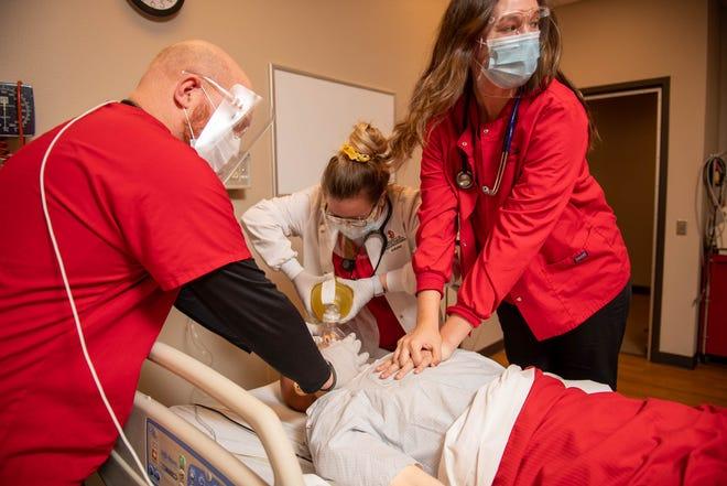Nursing students at the University of South Dakota hone their skills in a nursing simulation.