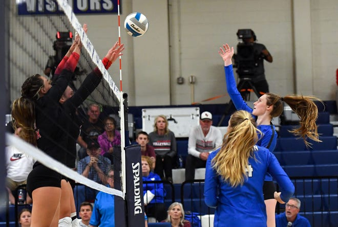 O'Gorman's Bergen Reilly hits the ball into a block by Brandon Valley players in a volleyball match on Tuesday, October 5, 2021, at O'Gorman High School in Sioux Falls.