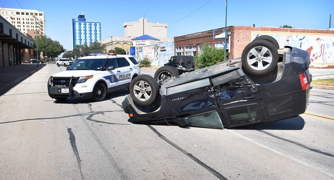 Wichita Falls Police and emergency personnel worked the scene of a two-vehicle, rollover accident at the intersection of 11th Street and Scott Avenue Wednesday afternoon.