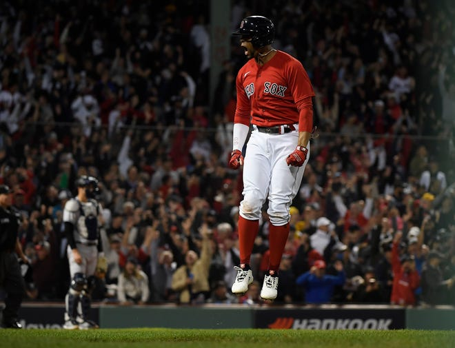 Red Sox shortstop Xander Bogaerts reacts after hitting a two-run home run off Gerrit Cole in the first inning.