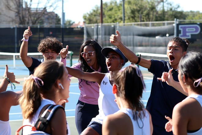 The Hendrickson tennis team celebrates its victory in the District 18-5A team tennis tournament. The Hawks beat Pflugerville on Monday to claim the regular-season title and grab the district's No. 1 playoff seed.