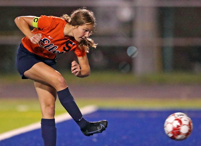 Ellet's Rachel Wenzel takes a shot during the second half of a soccer game against Firestone at Ellet High School, Wednesday, Oct. 6, 2021, in Akron, Ohio. [Jeff Lange/Akron Beacon Journal]