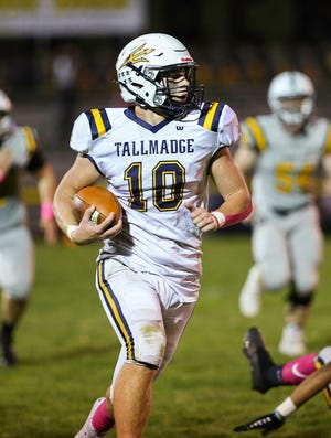 Tallmadge's Zander Hopkins breaks into the open on his way to a touchdonw Oct. 1 at Cuyahoga Falls. The Blue Devils scored a 41-7 at Falls to improve to 5-2 on the season.