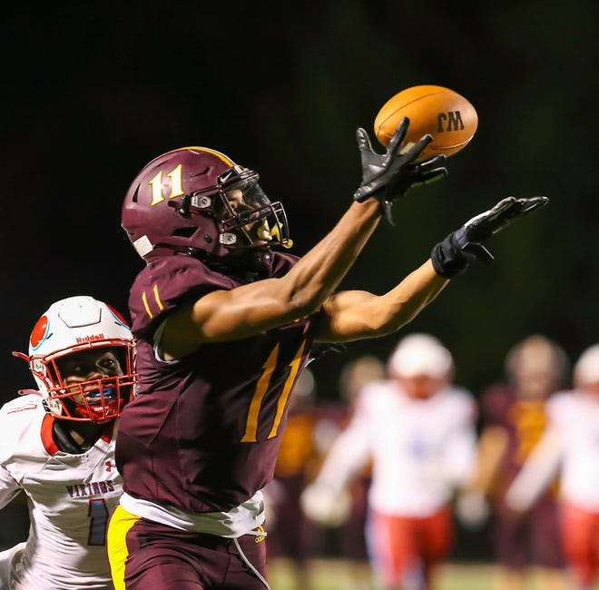 Walsh Jesuit receiver Trey Bell pulls in a pass during the Warriors' week six win over Villa Angela-St. Joseph. Walsh scored it fourth straight win Oct. 1 when it routed Notre Dame-Cathedral Latin 45-15 at Conway Memorial Stadium.