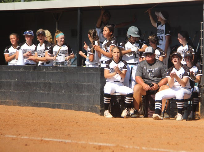 The Lady Horns cheer from the dugout Thursday during a 10-0 win over Ada. Lone Grove can punch a return ticket to the Class 4A State Tournament on Friday.