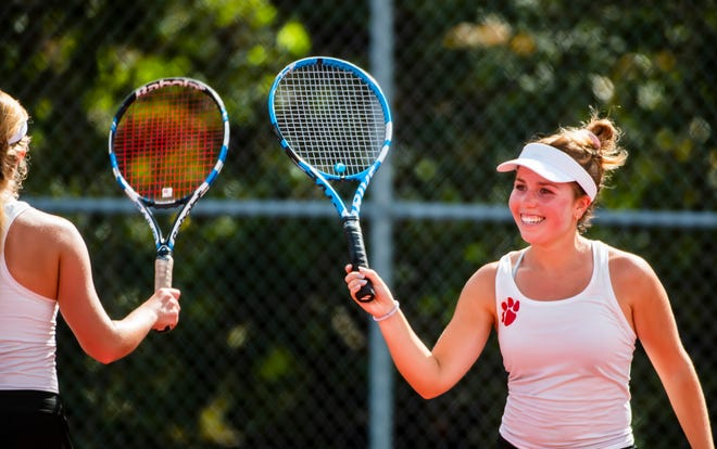 Moon High School's Amanda Koren, left, celebrates a point with teammate Maria Lounder during their WPIAL 3A doubles tennis consolation match Thursday at North Allegheny High School. [Lucy Schaly/For BCT]