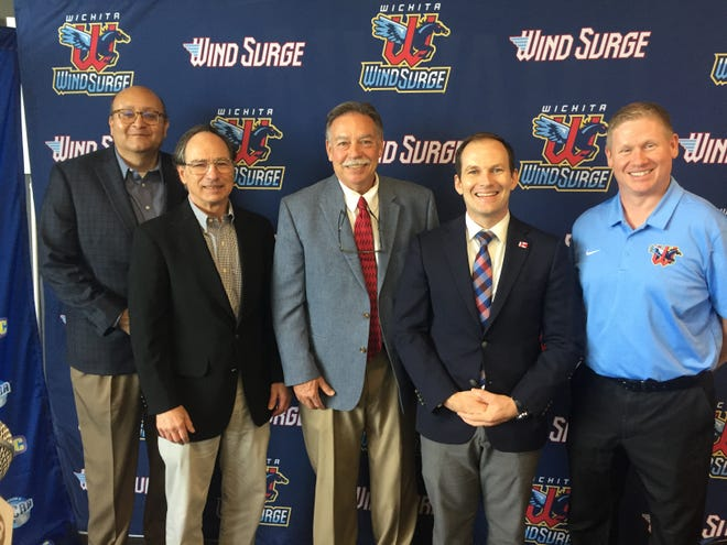 (From L-R) Mark Patrick, Jordan Kobritz, Carl Heinrich, Brand Whipple and Tim Grubbs all pose for pictures after announcing the Kansas Jayhawk Community College Conference and the Wichita Wind Surge, partnering with the City of Wichita will host the KJCCC conference championship on Nov. 21 at Riverfront Stadium.
