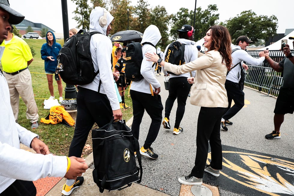 Missouri athletic director Desiree Reed-Francois greets MU football players as part of the Tiger Walk before the team's game against Tennessee on Oct. 2.