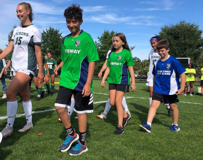 The YCYSL players were invited to escort both teams onto the field for the national anthem, just as in the professional leagues around the world.